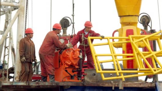 PetroChina workers at the site of an oil well in Xinjiang, China.